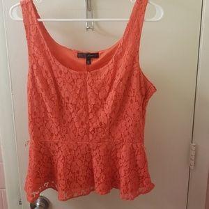 Coral lace sleeveless peplum top
